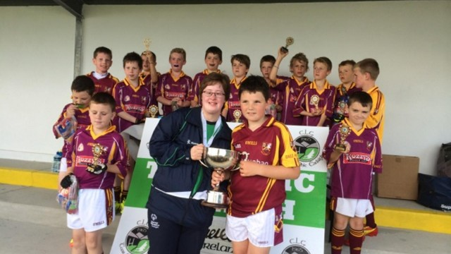 Stephen O'Connor, captain, accepts Munroe Cup (U10 tournament, Tourmakeady), 2014